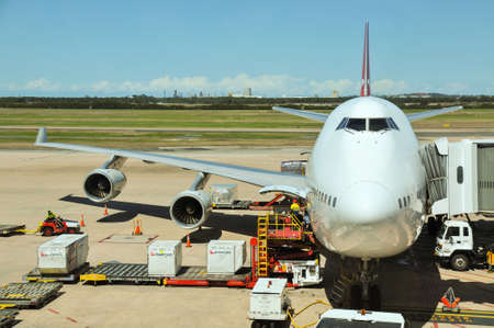 airplane cargo: Brisbane, Australia - October 4, 2011: Qantas operated Boeing 747-400 is being loaded at Brisbane International Airport Editorial