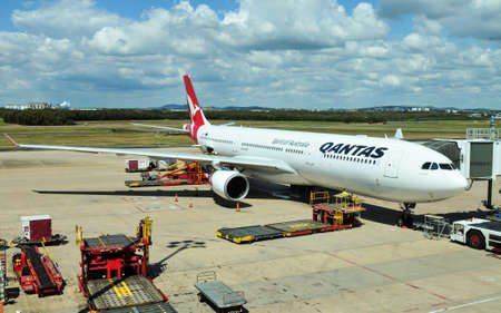 broken hill: Brisbane, Australia - September 7, 2015: Qantas operated Airbus A330-303 is being loaded at Brisbane International Airport, Australia