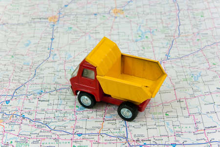 Toy Dump Truck  with Road map background photo