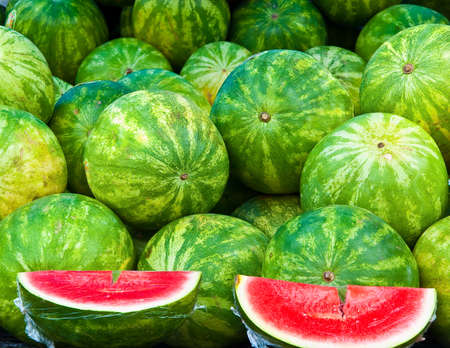 Bushel of watermelons with two cut sections