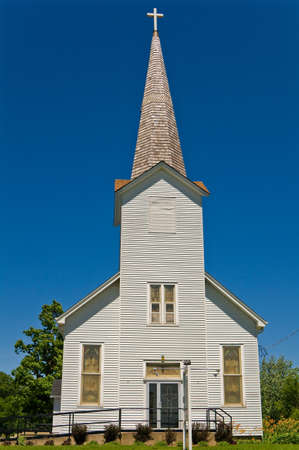 steeples: White steeple Church with wood shingles and blue sky backdrop Stock Photo