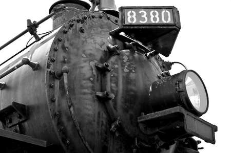 Closeup of steam locomotive in black and white