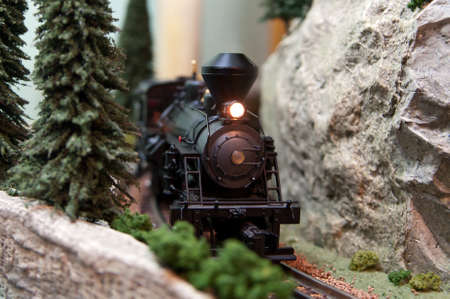 Black model Locomotive on track layout with headlamp