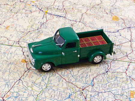 toy truck: Vintage toy pickup truck on a road map Stock Photo