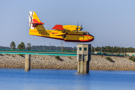 A big fire fighting plane in Portugal on a lake filling up water. Fire in Portugal.