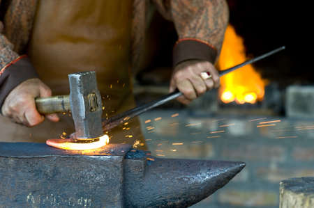medieval blacksmith: A blacksmith at the work