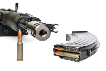 the silencer: Saiga MK-03, AK-47, magazine and bullet shells