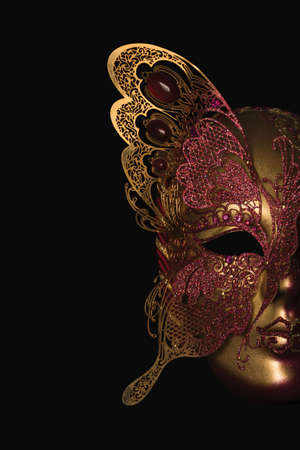 venecian: Gold tone Venecian carnival Mask black background