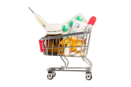 Drags and pills in shopping cart isolated
