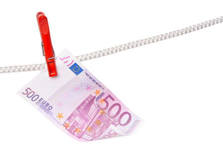 Euro and pins on the rope isolated