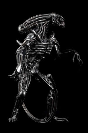 Melal monster figure of alien steampunk black background