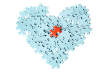Heart image puzzle pieces one bright puzzle piece white background