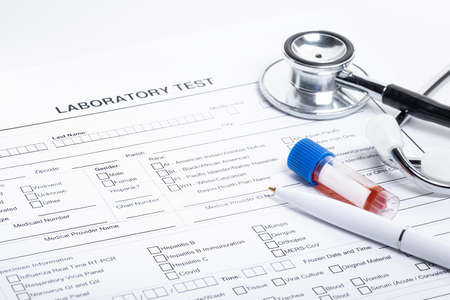 Empty form to fill of blood test, mask, pen and stetoscope