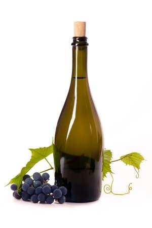 A bottle dark glass grape branch leaves cork white background