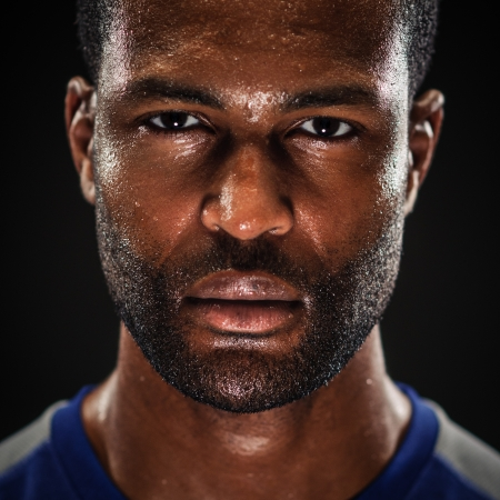 A young African American athlete blank expression studio portrait  photo