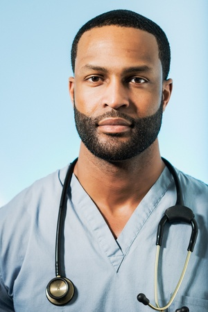 Studio shot of a young African American doctor  photo