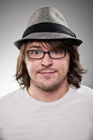 fedora hat: Fedora Wearing Caucasian Man With Glasses Making A Face