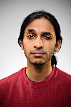 raised eyebrow: Young Indian Ethnic Man With A Raised Eyebrow
