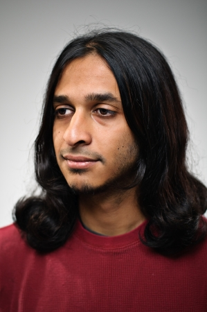 man with long hair: Young Indian Ethnic Man With A Blank Expression Profile