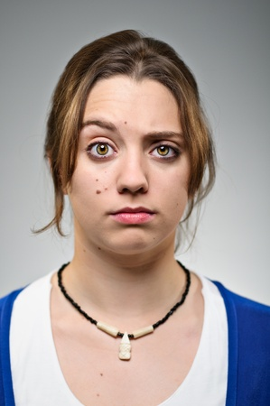 raised eyebrow: Young Caucasian Woman Raised Eyebrow Portrait