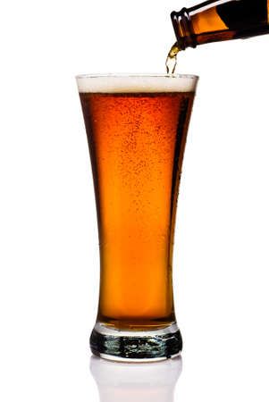 pint glass: Pouring an amber lager into a pint glass  Stock Photo