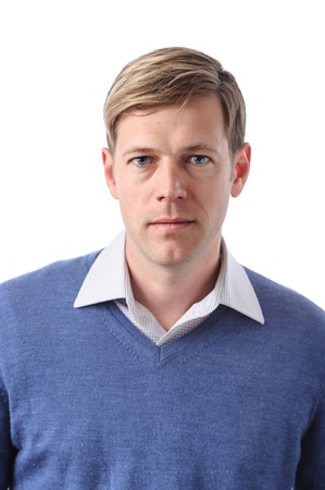 A young Caucasian man with a blank expression. photo