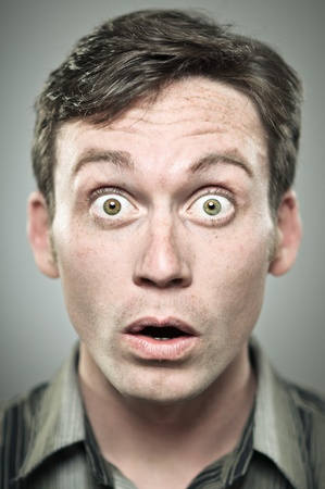 big mouth: Young Caucasian man wide eyed expression portrait Stock Photo