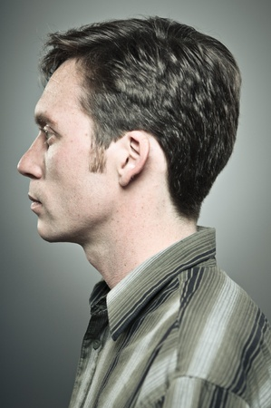 profile: Young Caucasian Man Blank Expression Portrait In Profile Stock Photo