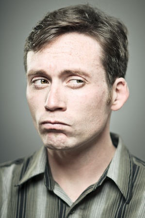 suspicious: Young Caucasian man with a suspicious expression Stock Photo