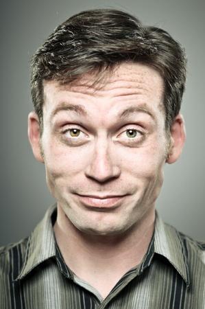 smug: Young Caucasian man smug expression portrait Stock Photo