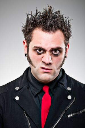 spiked hair: A young man in his 20s dressed up as an emo goth character.