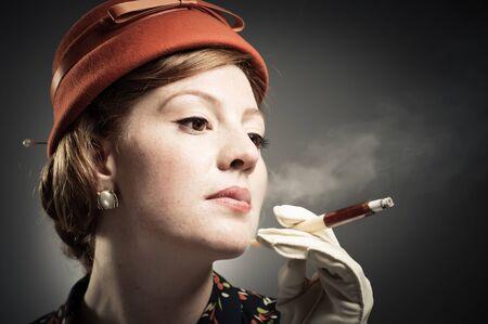 A classic beauty smoking a cigarette. photo