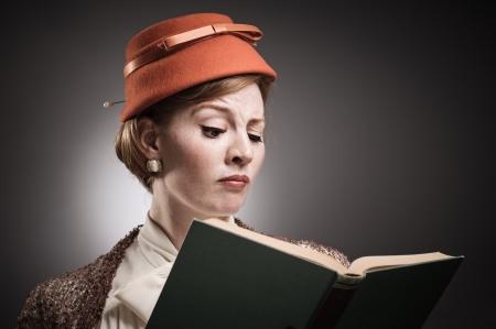 A woman in retro garb reading a book.