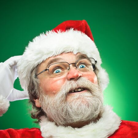 A confused Santa Claus scratching his head.