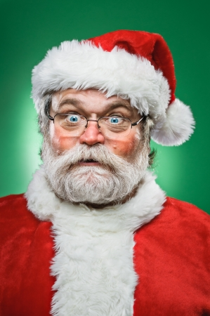 A crazy Santa Claus making a weird face. photo