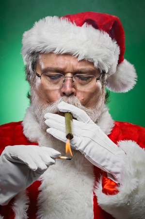 A bad Santa smoking a cigar.