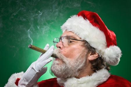 A bad Santa smoking a cigar.