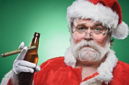 A bad Santa smoking a cigar and drinking beer. Stok Fotoğraf
