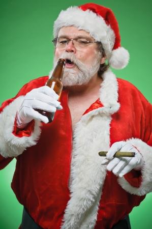 A bad Santa smoking a cigar and drinking a martini.