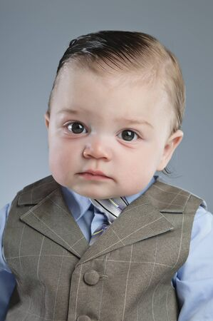A 7 month old baby dressed in a suit. Stock Photo