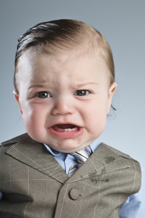 slicked: A 7 month old baby dressed in a suit. Stock Photo