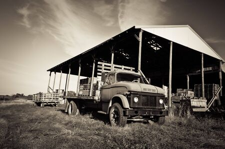 A rural scene with an old farm truck. photo