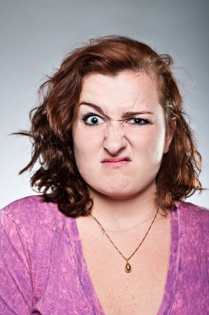 A Caucasian woman in her 20s with a negative expression.