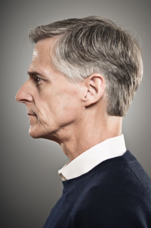 profile: A mature man in his 50s with his eyes close.