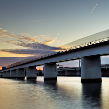 A speeding Metro rail train going over an elevated railway over the Potomac River in Washington DC.