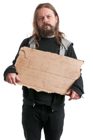 A homeless man holding a cardboard sign, isolated on white.