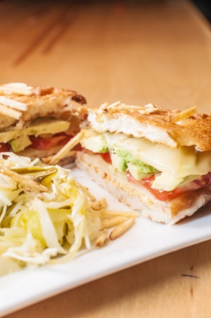 gruyere: A vegetarian panini with avocado, tomato, and gruyere cheese. Stock Photo