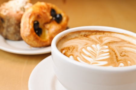 Decorative cappucino and pastries.