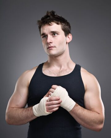 A young tough preparing for a fight.