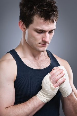 man looking down: A young tough preparing for a fight. Stock Photo